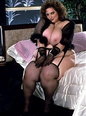 Huge Babe on Stockings Teasing and Licking Big Boobs